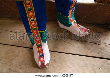 Feet of a monk dressed in traditional costume, Paro, Bhutan, Asia - Stock Photo
