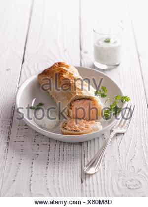 Salmon in puff pastry crust - Stock Photo