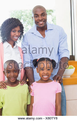Happy family standing and smiling at camera - Stock Photo