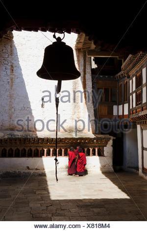 Kingdom Bhutan, monks in the cloister, - Stock Photo