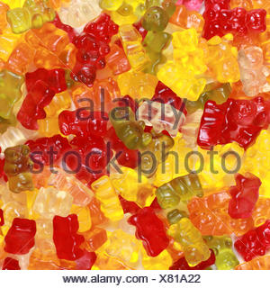 many colorful jelly beans lying on a table - Stock Photo