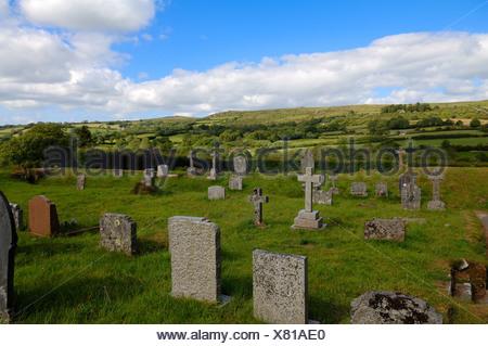 Old cemetery of the church of St. Pancras overlooking the landscape of Dartmoor, Widecombe in the Moor, Dartmoor, Devon, England - Stock Photo