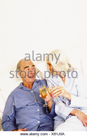 Man and woman proposing toast - Stock Photo