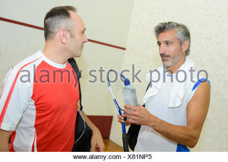 Men chatting after game of squash - Stock Photo
