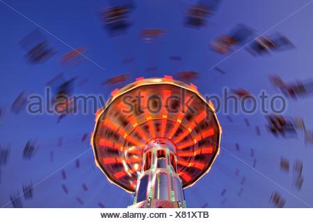 Night scene, fisheye shot, Chair-O-Planes or Swing Carousel, Cannstatt Festival, Stuttgart Beer Festival, Stuttgart, Baden-Wuer - Stock Photo