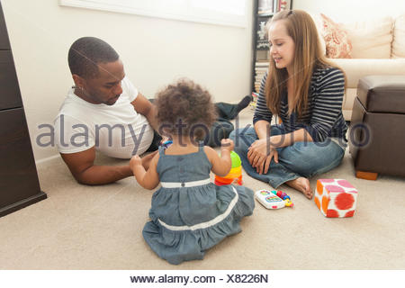 Mother and father playing with young daughter