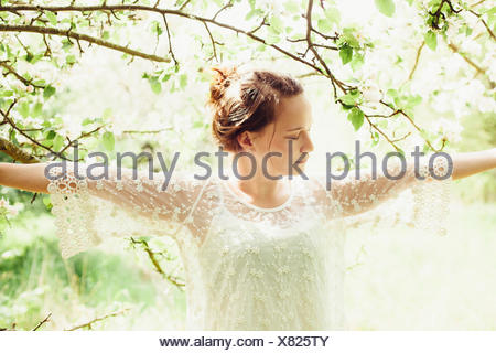 young woman happily in nature - Stock Photo
