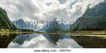 Miter Peak reflected in the water, Milford Sound, Fiordland National Park, Te Anau, Southland Region, Southland, New Zealand - Stock Photo