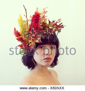 Portrait of a woman wearing a floral headdress - Stock Photo