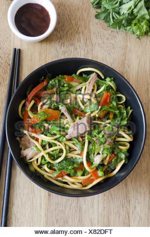 Sweet and aromatic pulled pork noodles in a bowl. - Stock Photo