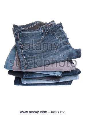 stack of various jeans isolated on white background - Stock Photo