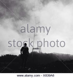 Man Standing Among Smoke - Stock Photo