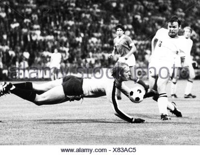 sports, football, games, Germany, DFB-Pokal 1969 / 1970, quarter final, game Borussia Moenchengladbach versus 1. FC Koeln (2:3), Boekelbergstadion, Gelsenkirchen, 5.8.1970, goal keeper Manfred Manglitz (Cologne repelling the attack of striker Herbert Laumen, DFB cup, football match, soccer match, football matches, footballer, footballers, kicker, football player, football players, action, act, actions, acts, attack, offensive move, attacks, offensive moves, defences, defenses, defense, defence, save, military parade, running, run, runs, jumping, jumps, jump, pl, Additional-Rights-Clearences-NA - Stock Photo