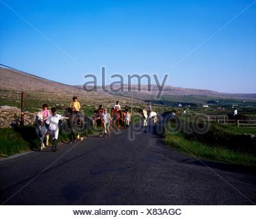 Fanore Beach, Burren, Co Clare, Ireland; Pony Trekking - Stock Photo