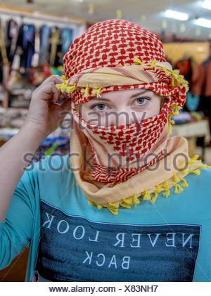 girl of Slavic appearance wearing a headscarf Arab - Stock Photo