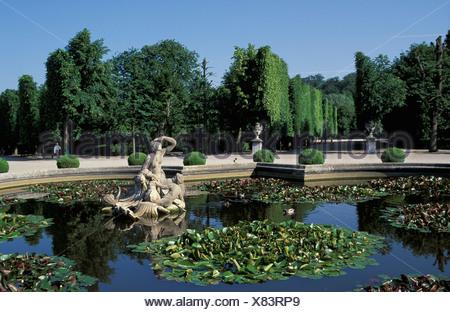 Austria Europe Vienna Schonbrunn Palace gardens park historic Bundesgarten fountain pond water plants - Stock Photo