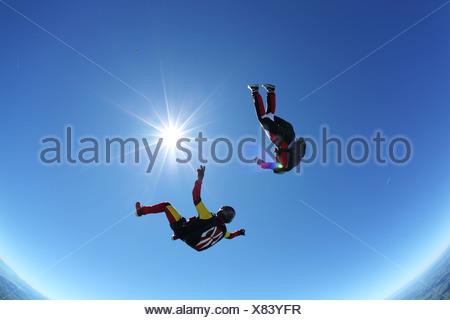 Skydivers upside down above Leutkirch, Bavaria, Germany - Stock Photo