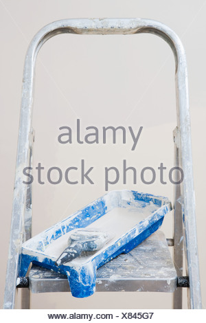 Ladder and a tray of paint - Stock Photo
