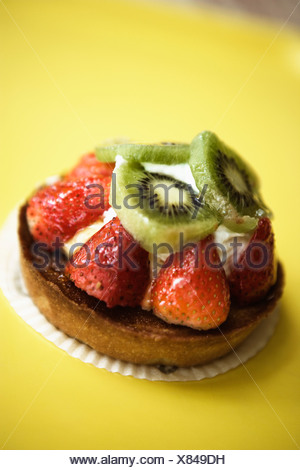 Close-up of a strawberry tart on a serving tray - Stock Photo