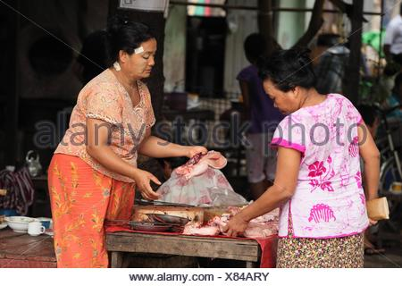 Burma women Selling chicken at Local Market yangon myanmar - Stock Photo