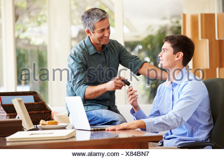 Father Giving Teenage Son Car Keys - Stock Photo
