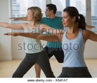 Multi-ethnic people in yoga class - Stock Photo