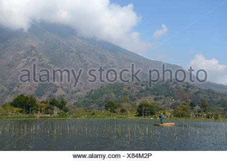 Central America, Guatemala, Lago de, Atitlan, lake, Santiago, boat, mountains, volcano, rim of fire, landscape, fisherman, Solol - Stock Photo