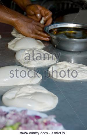 Kuala Lumpur, Malaysia; A Person Preparing Food - Stock Photo