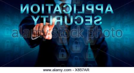 Executive Pushing APPLICATION SECURITY Onscreen - Stock Photo