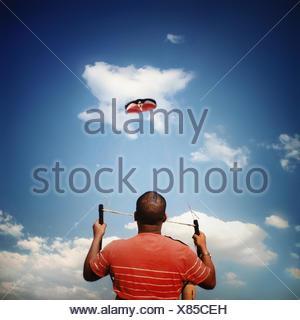Man flying kite - Stock Photo