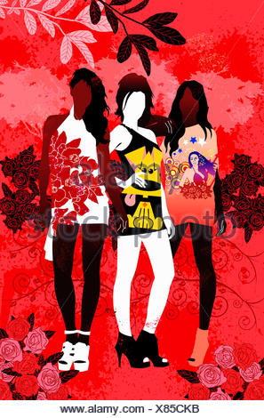 Fashionable teenage girls wearing t shirts posing in red countryside - Stock Photo