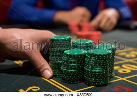Hand betting gambling chips - Stock Photo