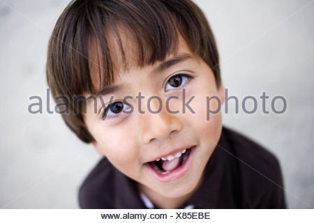 Young boy making face - Stock Photo