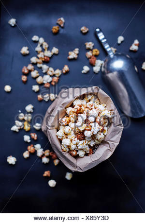 Popcorn in a brown paper bag - Stock Photo