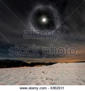 Europe, Italy, Trentino Alto Adige, lunar rainbow over meadows of Non valley, - Stock Photo