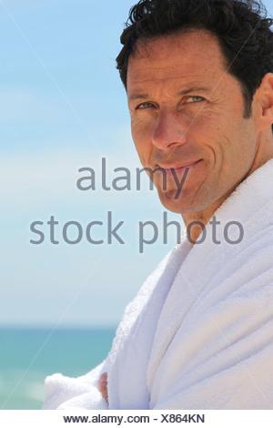 Man in bathrobe - Stock Photo