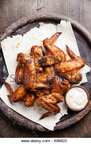 Fried Chicken Wings with sauce - Stock Photo