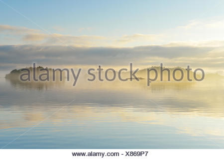 Sweden, Stockholm Archipelago, Uppland, Lidingo, View of sea and islands at dawn - Stock Photo