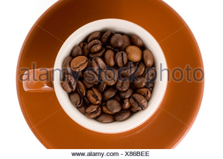 Espresso cup filled with coffee beans - Stock Photo