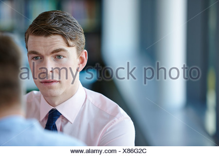 Young businessman in shirt and tie - Stock Photo