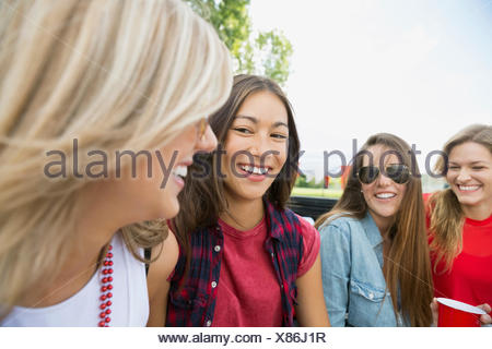 Women smiling together outdoors - Stock Photo