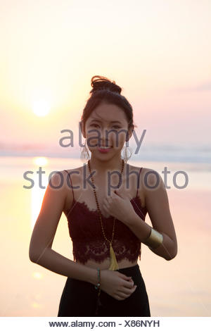 Portrait of a smiling woman on beach, Bali, Indonesia - Stock Photo