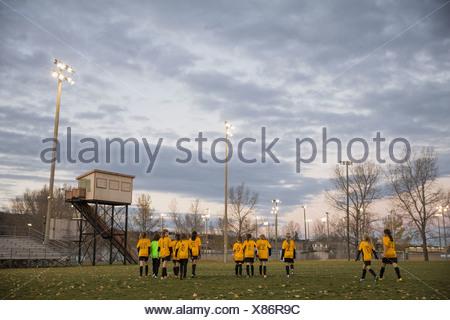 Soccer team walking on field - Stock Photo