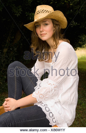 A female wearing a cowgirl hat - Stock Photo