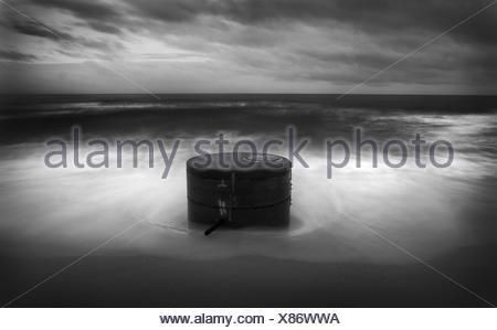 Ocean Waves crashing on a pillar - Stock Photo