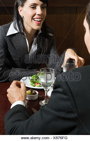 Colleagues in restaurant - Stock Photo