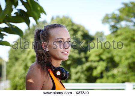 Portrait of young female runner looking away - Stock Photo