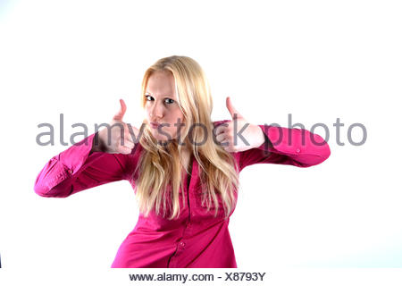 Young blond woman with two thumbs up - Stock Photo
