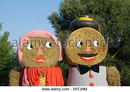 Two figures made out of straw bales - Stock Photo