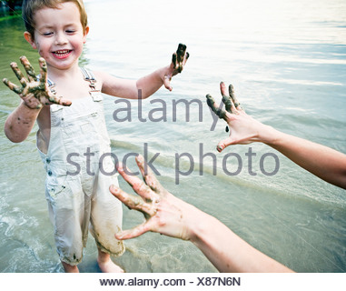 child showing dirty hands - Stock Photo